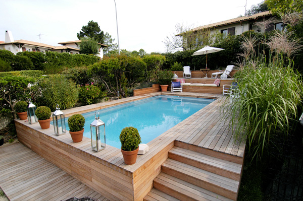 Structure bois cr apiscine for Piscine semi enterree desjoyaux